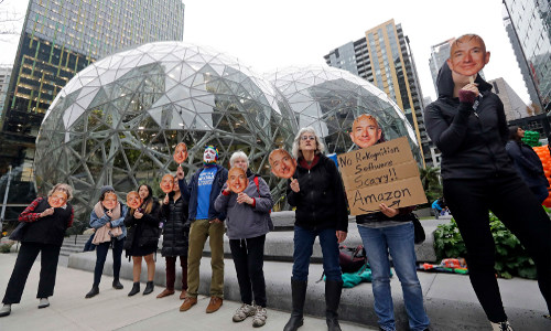 Demonstrators protest at Amazon HQ the company's facial recognition system.